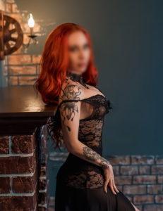 Claudia Redhead Escort
